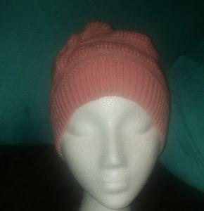 Pink ponytail stocking hat.